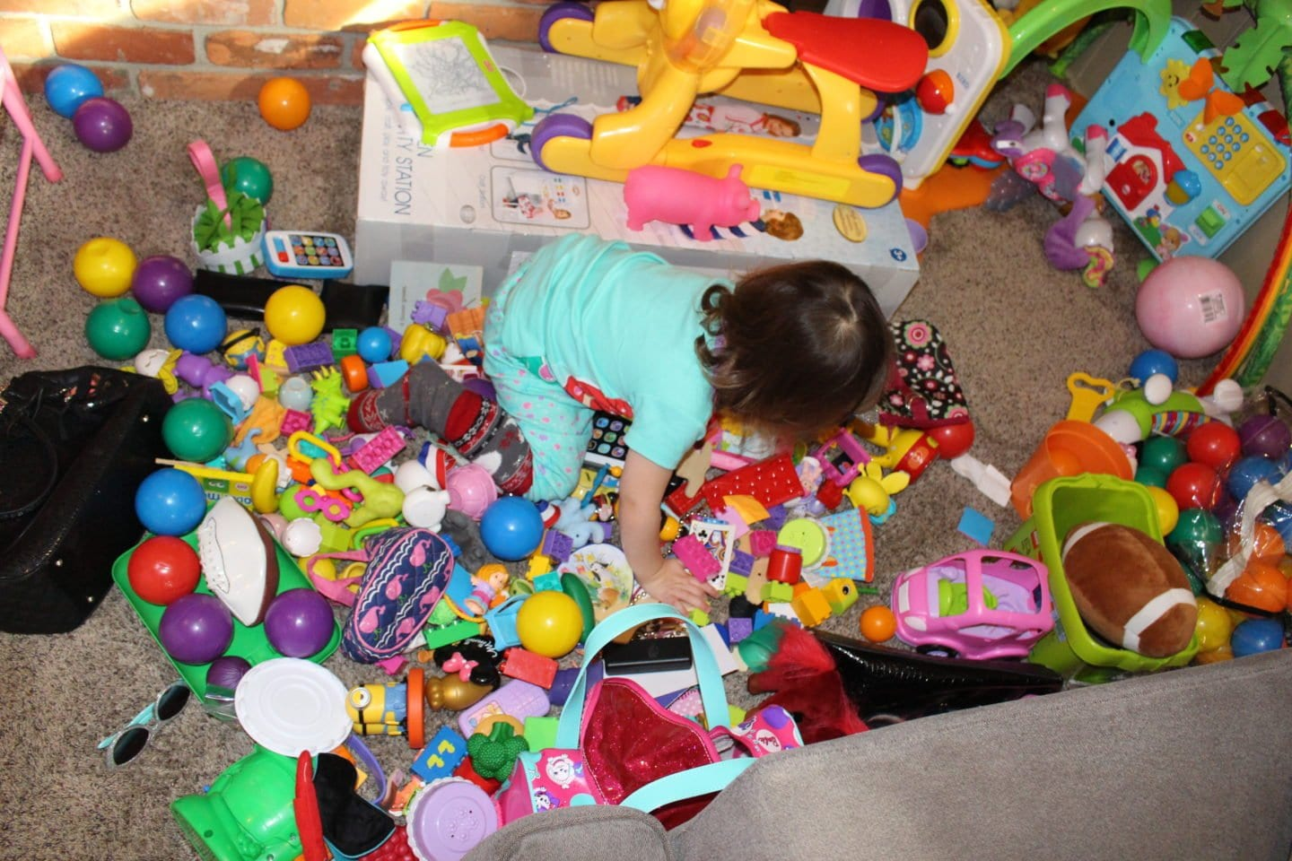 After Libby's 2nd birthday toys began taking over the living room. I knew I had to change something.